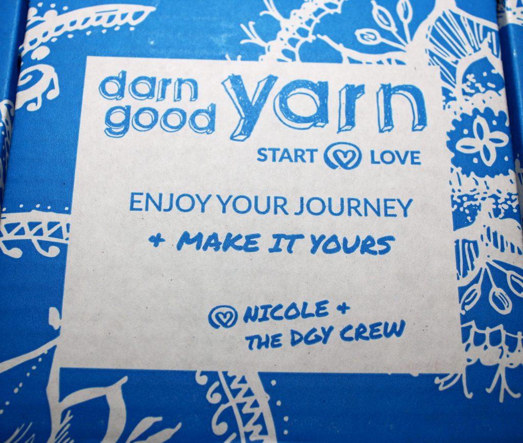 a blue box that says Darn Good Yarn