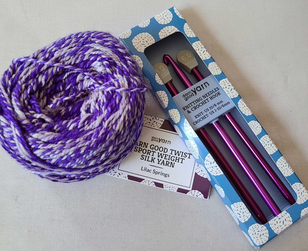 a photo of yarn and needles