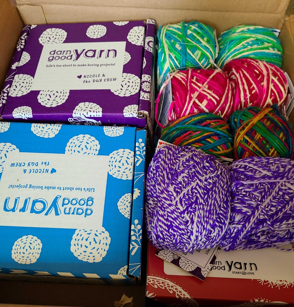 a photo of a box of yarn and crafts