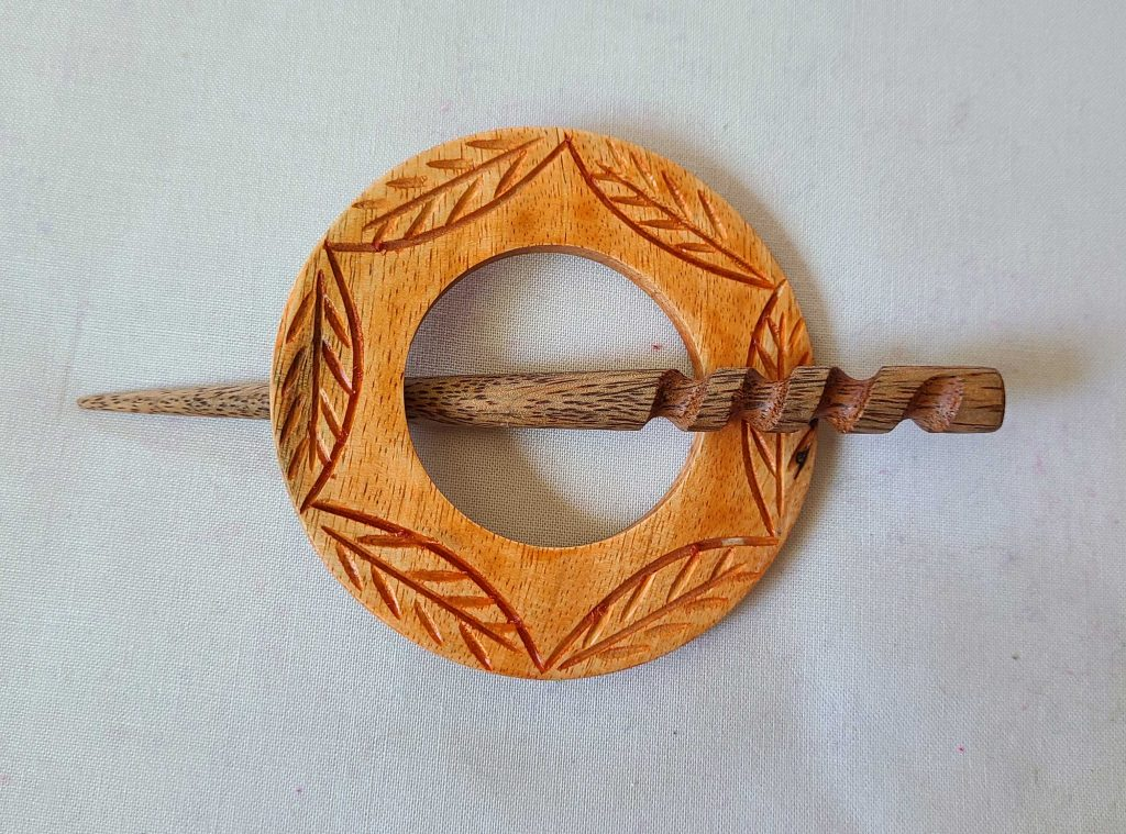 a photo of a wooden shawl pin